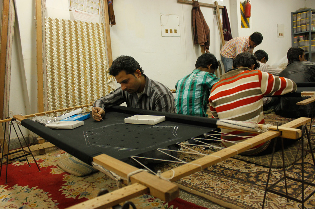 'addas', or embroidery frames, fill up the room where artisans work to develop stunning hand embroidered pieces.